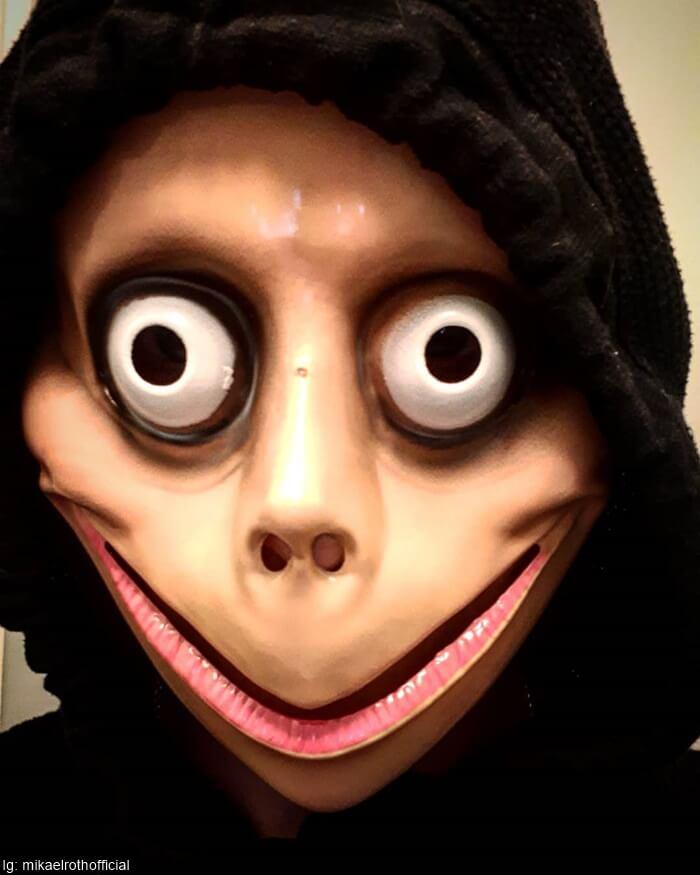 Máscara de momo para ilustrar Máscaras de terror infaltables en Halloween